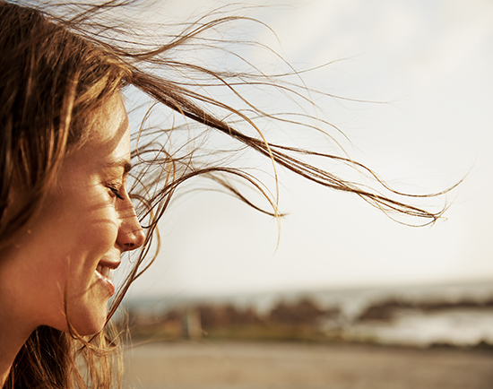the lady with the long hair blowing in the wind